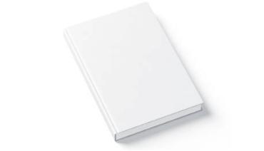 Un livre blanc sur une table blanche